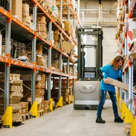 woman-at-work-putting-boxes-on-the-shelves-beside-2021-04-05-01-30-54-utc