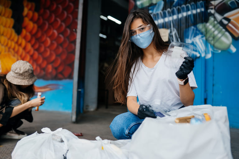 young-woman-sorting-garbage-concept-of-recycling-z-75WUD6W