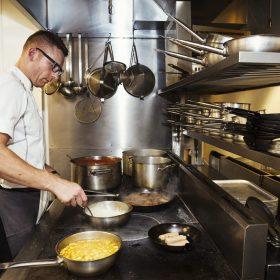 chef-cooking-in-a-restaurant-kitchen-2021-04-04-10-02-06-utc